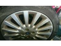 Three fiat punto alloys with tyres