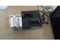Sony PlayStation 3 with 2 controllers and 12 games