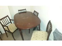 Brown wooden dinner table + 6 chairs