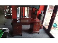 Solid dark wood dressing table with moveable mirrors and plenty of drawers