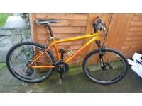 Planet X mountain bike in metallic orange great condition full working order