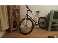 Carrera Valour mountain bike needs a bit of work hence price
