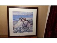 A gorgeous print of a painting of two girls in a bed of flowers by the sea