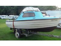 Fishing Boat For Sale. Includes 15hp Johnson Outboard Motor.