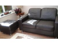 Two seater brown sofa and footstool