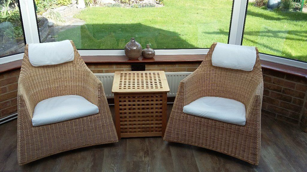 Two Wicker Rocking chairs and a storage box.