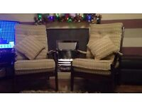 Matching pair of Parker knoll easy chairs