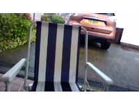 Two Blue Fold Up Chairs & One striped Fold Up Chair