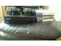 Ps2 with 2 pads and 10 games