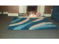 teal/blue rug