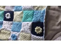 Hand knitted crochet baby blanket blue