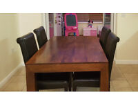 Real Mango wood dining table with 4 chairs. All in Good condition.