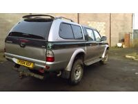L200 2.5TD 4life, with metal canopy but for extra £500 can come with the stylish canopy