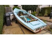 Wayfarer sailing dinghy on galvanised road trailer