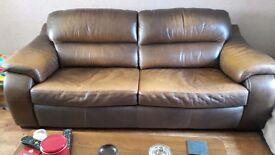 Brown 2 seater leather sofa. Worn look. Only £145!