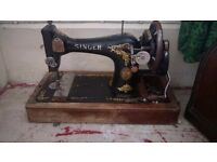 Singer sewing machine hand cranked been restored with case