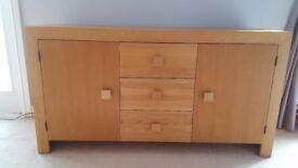 Oak veneered side board.