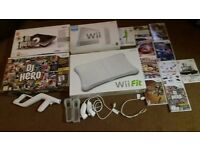 Wii console with games and 2 DJ hero