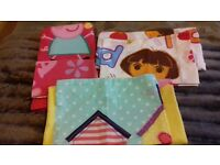 dora and peppa pig cotbed duvet sets. good condition . includes duvet cover and and pillow case set