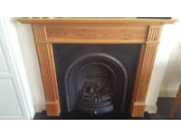 Cast Iron fireplace with pine wood surround and slate hearth