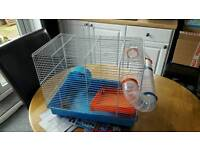 Hamster cage with tube, platform and wheel