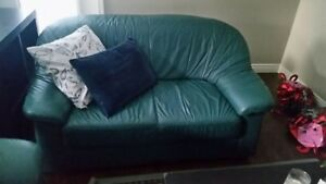 Two Leather Couches, a Coffee Table, and a Reclining Chair $160