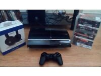 Ps3 console 60gb plus 16 games ps3 headset and 1 wireless controller