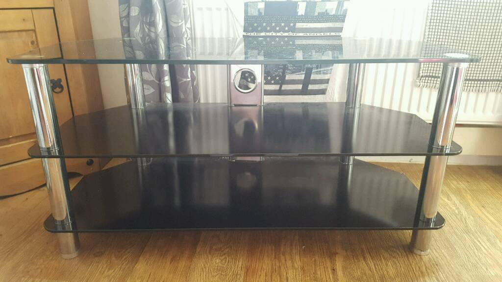 "Large tv unit holds up to 55"" tv"