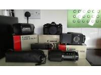 Canon A-1 with original box, 70-210 lens, power winder, flash gun and original leather case