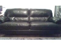 BLACK LEATHER SOFA AND CHAIR EXCELLANT CONDITION 18 MONTHS OLD FROM SOFOLOGY