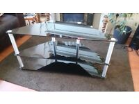 Black glass tv stand. Excellent condition.