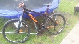 Mens black and orange fuji moutain bike