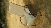 2 garden loungers faded green color with brown metal frame