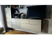 IKEA BESTA TV/ STORAGE UNIT with glossy beige doors plus 2 matching floating shelves