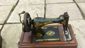 Two hand cranked singer sewing machines