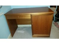 Solid wooden desk for sale with pull-out drawer and cupboard.