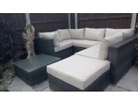 Excellent condition NEXT dark brown rattan set with cream cushions and glass top coffee table