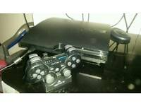 Ps3 slim console and 14 games