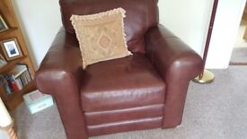 Brown leather settee , chair and foot stool.