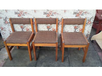 3 wood framed chairs with padded seats