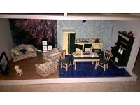 Modern style sturdy made Dolls house with all furniture included. Barbie's sister size will fit