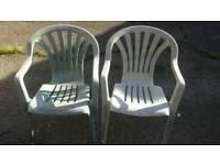 Green plastic garden chairs