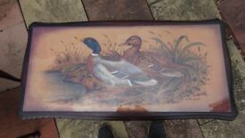 antique table withwild ducks on it.