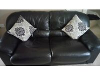 Black faux leather sofa and chair