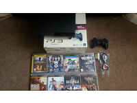 Sony PS3 Slim Console 160GB plus 1 x controller and 8 games.