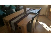6 months old solid beech table and 4 chairs and accesories