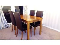 Dining table with 4 brown faux leather dining chairs