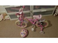 Girls first bike with bag and helmet