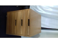Pine chest of 3 drawers on wheels.
