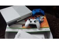 X box 1s perfect working order in box. 2 controller's with Call of duty WW11